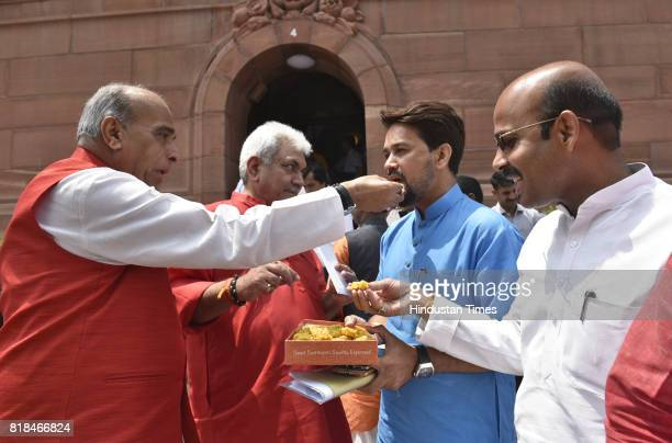 The BJP leader Ambika Prasad offer and Manoj offer sweets to Anurag Thakur as Venkaiyah Naidu came to file his nomination for the vice president At...