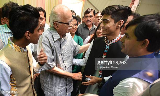 The BJP leader Lal Krishna Advani with BJP leader Syed Shahnawaz Hussain and his sons Arbaaj Hussain and Adeeb Hussain during the Iftar Party at...