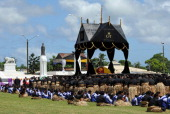 The black and gold catafalque carrying the casket of King George Tupou V arrives at Mala'ekula at the end of the king's funeral procession through...