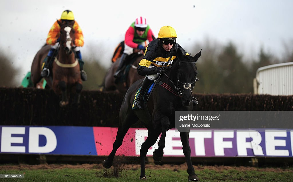 The Black Baron ridden by Leighton Aspell wins the Tim Barclay Memorial Steeple Chase on February 15, 2013 in Fakenham, England.