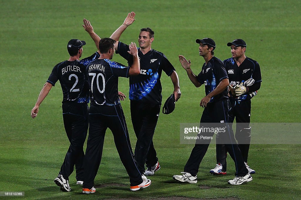 The Black Caps celebrate winning the international Twenty20 match between New Zealand and England at Seddon Park on February 12, 2013 in Hamilton, New Zealand.