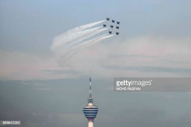 TOPSHOT The Black Eagles the aerobatic team of T50 jets belonging to South Korea's air force fly in formation above the Kuala Lumpur Tower during a...