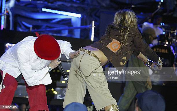 The Black Eyed Peas perform at the annual 'Isle of MTV 2004' summer dance party event on the beach in Tossa De Mar on July 12 2004 in Spain