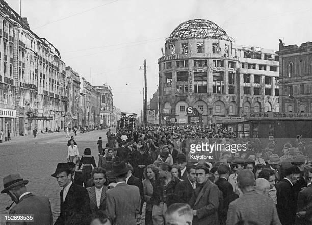 The Black Market at Potsdamer Platz in Berlin with the ruined dome of the Haus Vaterland in the background and the Potsdamer Station on the extreme...