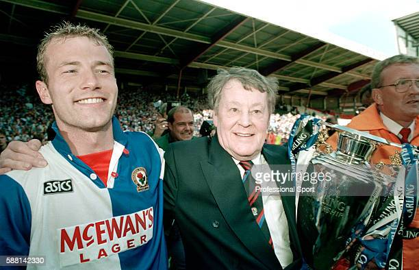 The Blackburn Rovers owner and chairman Jack Walker celebrating with Alan Shearer and the FA Premier League Championship trophy following their match...