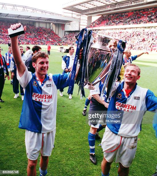 The Blackburn Rovers strike force of Alan Shearer and Chris Sutton hoist the FA Crling Premiership trophy at Anfield where they won the title despite...