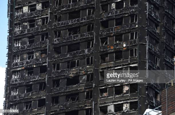 The blackened shell of Grenfell Tower in west London as survivors of the fire have resorted to searching for new homes privately out of frustration...