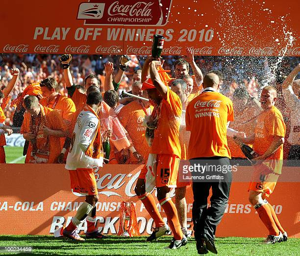 The Blackpool Team celebrate promotion to the Premier League after victory in the CocaCola Championship Playoff Final between Blackpool and Cardiff...