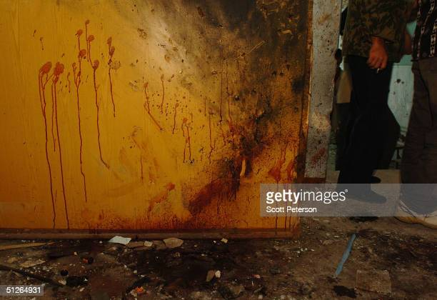 The blood of a female 'shahid' suicide bomber remains painted on a wall near the corner where the Chechen militant blew herself up in the ruins of...