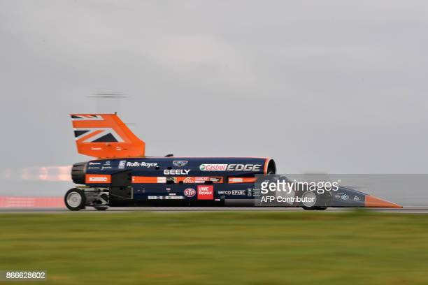 The Bloodhound supersonic car driven by Andy Green Royal Air Force Wing Commander makes a test run at the airport in Newquay on October 26 2017 The...