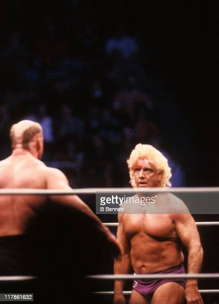 The bloodied 'Nature Boy' Rick Flair backs down from Road Warrior Hawk during their Heavy Weight bout at the 1988 Bunkhouse Stampede on January 24...