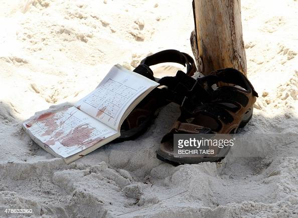 The bloodstained belongings of a tourist are seen on the sand in the resort town of Sousse a popular tourist destination 140 kilometres south of the...