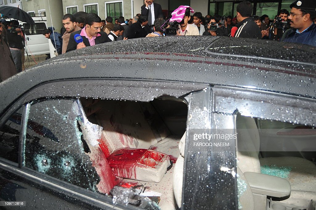 The blood-stained car of Pakistani Minorities Minister Shahbaz Bhatti following an attack in Islamabad on March 2, 2011. Gunmen shot dead a Catholic Pakistani government minister on March 2, after he had vowed to defy death threats following the murder of another politician opposed to an Islamic blasphemy law. AFP PHOTO/Farooq NAEEM