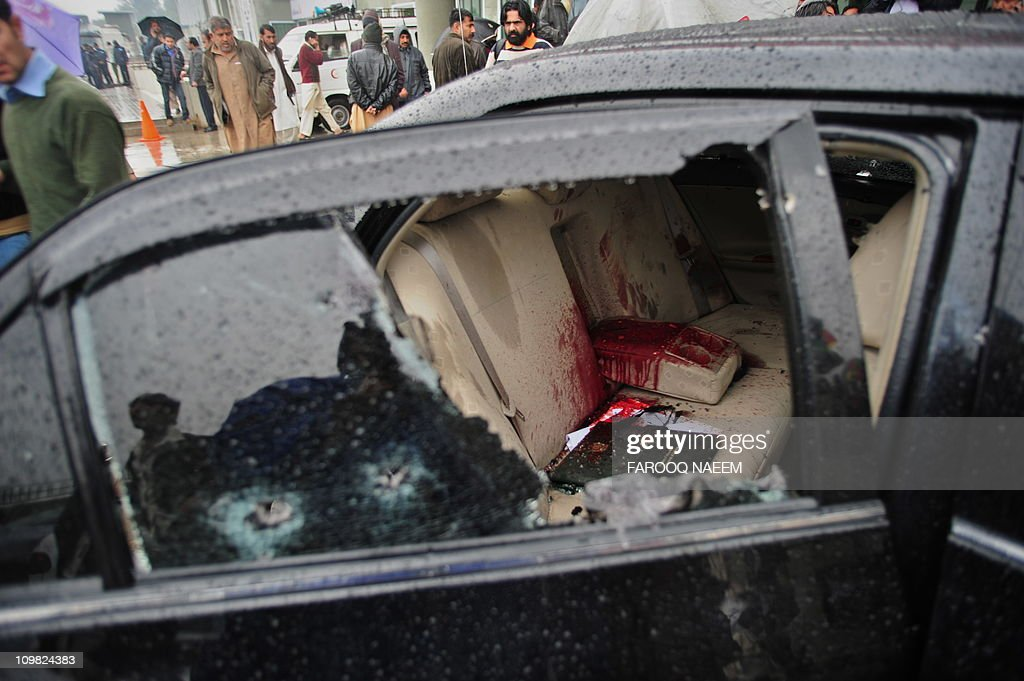 The bloodstained car of Pakistani Minorities Minister Shahbaz Bhatti is seen following an attack in Islamabad on March 2 2011 Gunmen shot dead a...