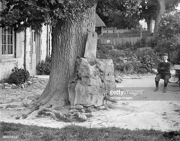 The Blowing Stone Kingston Lisle Oxfordshire c1860c1922 The Blowing Stone is a naturally perforated sarsen which emits a sound when blown into Legend...