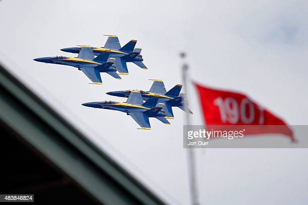 The Blue Angels fly around the Wrigley Field area while practicing before the weekend's Chicago Air and Water Show during the game between the...