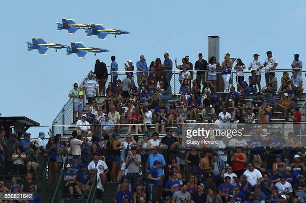 The Blue Angels fly around Wrigley Field during a game between the Chicago Cubs and the Toronto Blue Jays on August 20 2017 in Chicago Illinois