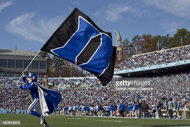The Blue Devils mascot carries the Duke flag during the second quarter of a college football game against the North Carolina Tar Heels at Kenan...