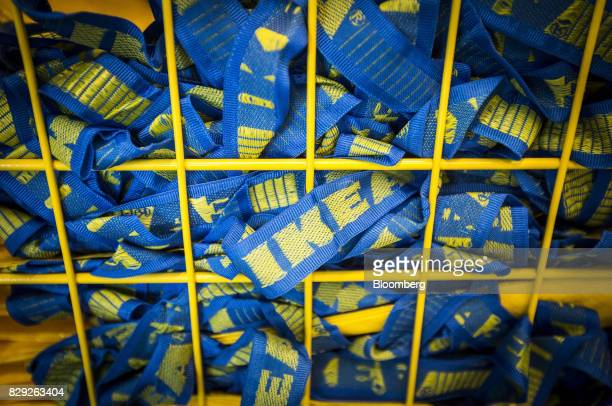 The blue handles of yellow IKEA shopping bags sit in a collection cage on the opening day of IKEA of Sweden AB's first department store in Belgrade...