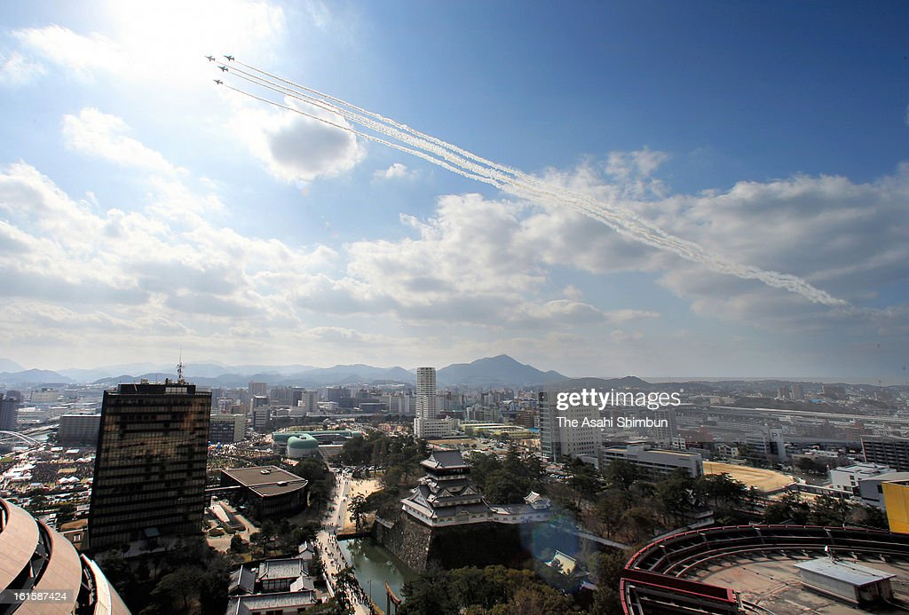 The Blue Impulse (T-4), the Japan Air Self-Defense Force aerobatic demonstration team, perform to celebrate the 50th anniversary of Kitakyushu City foundation on February 10, 2013 in Kitakyushu, Fukuoka, Japan.