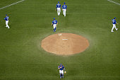 The Blue Jays infield after a meeting on the mound with RA Dickey in the first inning during game 4 of the American League Championship Series...