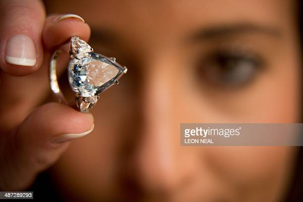 'The Blue' the largest flawless vivid blue diamond in the world is pictured during a photocall at Christie's auction house in London on April 29 2014...