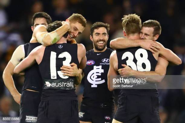 The Blues celebrate at the final siren and winning the round 22 AFL match between the Carlton Blues and the Hawthorn Hawks at Etihad Stadium on...