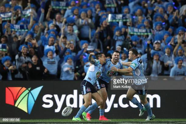 The Blues celebrate the try scored by Mitchell Pearce during game two of the State Of Origin series between the New South Wales Blues and the...