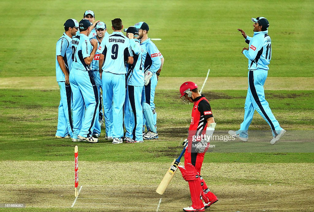 The Blues celebrate the wicket of Callum Ferguson of the Redbacks off the bowling of Trent Copeland during the Ryobi Cup One Day match between the New South Wales Blues and the South Australian Redbacks at Sydney Cricket Ground on February 14, 2013 in Sydney, Australia.