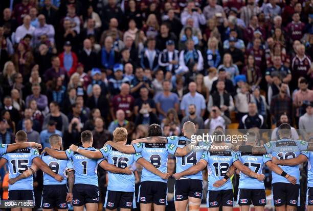 The Blues embrace before game one of the State Of Origin series between the Queensland Maroons and the New South Wales Blues at Suncorp Stadium on...