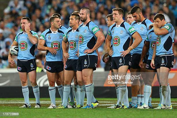 The Blues look dejected after a Maroons try during game three of the ARL State of Origin series between the New South Wales Blues and the Queensland...