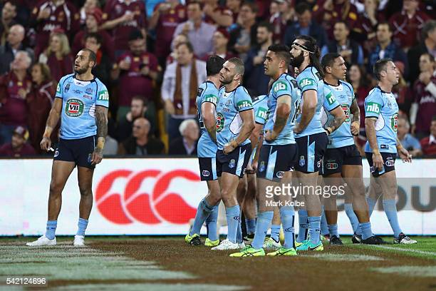 The Blues look dejected after a try during game two of the State Of Origin series between the Queensland Maroons and the New South Wales Blues at...