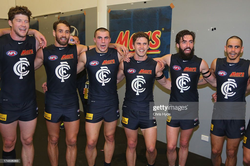 The Blues sing the team song after winning the round 18 AFL match between the Gold Coast Suns and the Carlton Blues at Metricon Stadium on July 27, 2013 in Gold Coast, Australia.