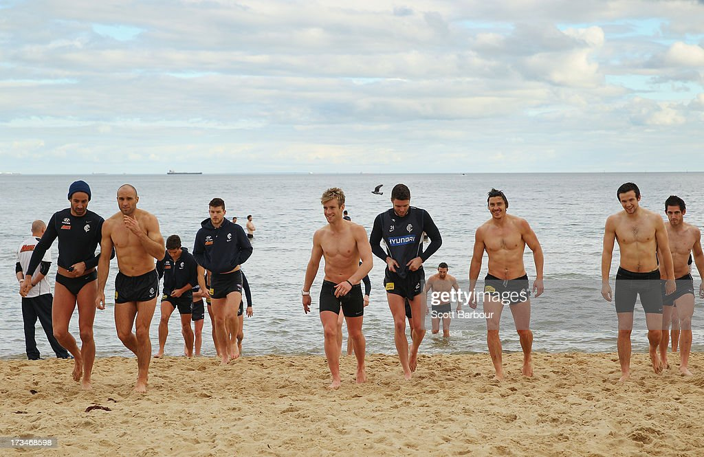 The Blues walk out of the water during a Carlton Blues AFL Recovery Session at St Kilda Sea Baths on July 15, 2013 in Melbourne, Australia.