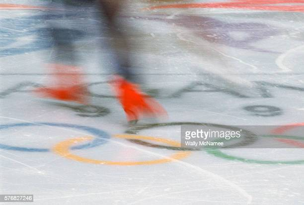 The blurred feet of Ukrainian ice dancer Ruslan Goncharov as he performs the free dance program in White Ring during the 1998 Winter Olympics