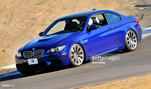 The BMW 2008 M3 coupe is driven on a downward turn at Laguna Seca Raceway in Monterey California US on Tuesday Feb 12 2008 The car features a 4liter...