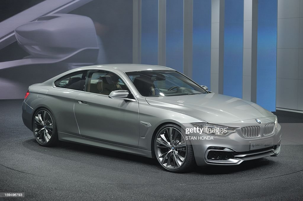The BMW 4 Series Coupe concept car is introduced at the 2013 North American International Auto Show in Detroit, Michigan, January 14, 2013. AFP PHOTO/Stan HONDA