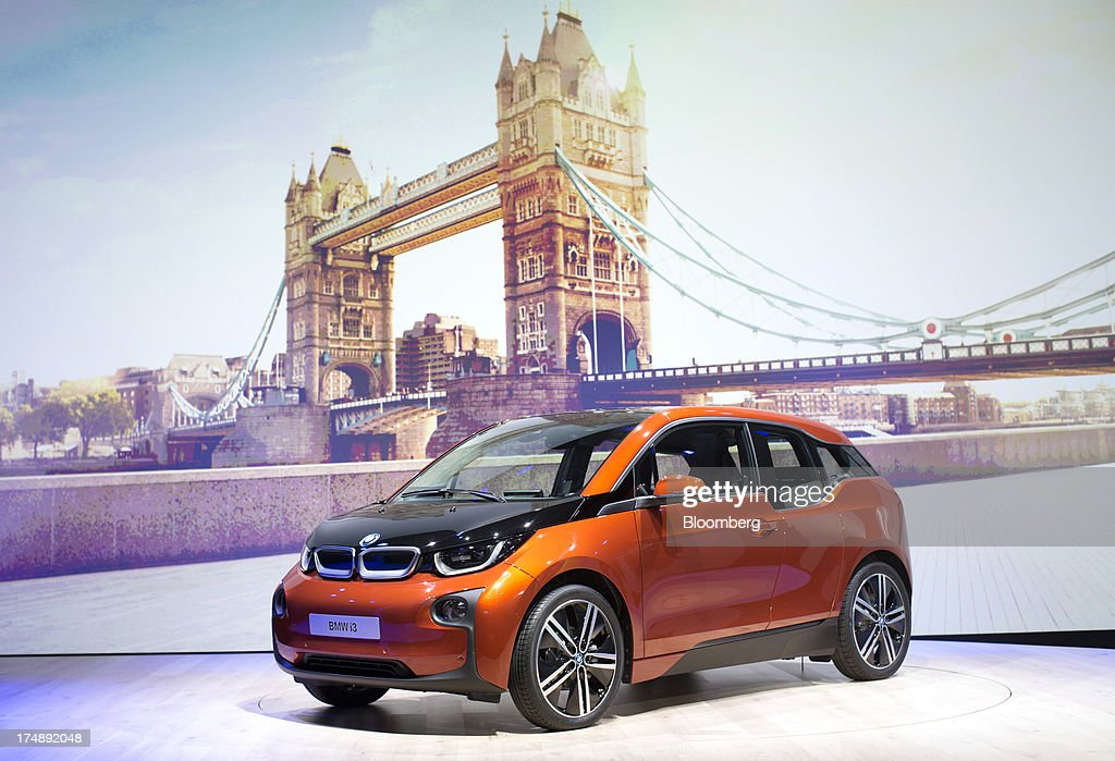 The BMW i3, the electric automobile produced by Bayerische Motoren Werke AG (BMW), is unveiled against a giant poster of Tower Bridge at the world premiere launch in London, U.K., on Monday, July 29, 2013. To avoid the fate of other slow-selling electric vehicles, Bayerische Motoren Werke AG will offer the new i3 -- a battery-powered compact car -- with a unique option: the use of a sport-utility vehicle. Photographer: Simon Dawson/Bloomberg via Getty Images