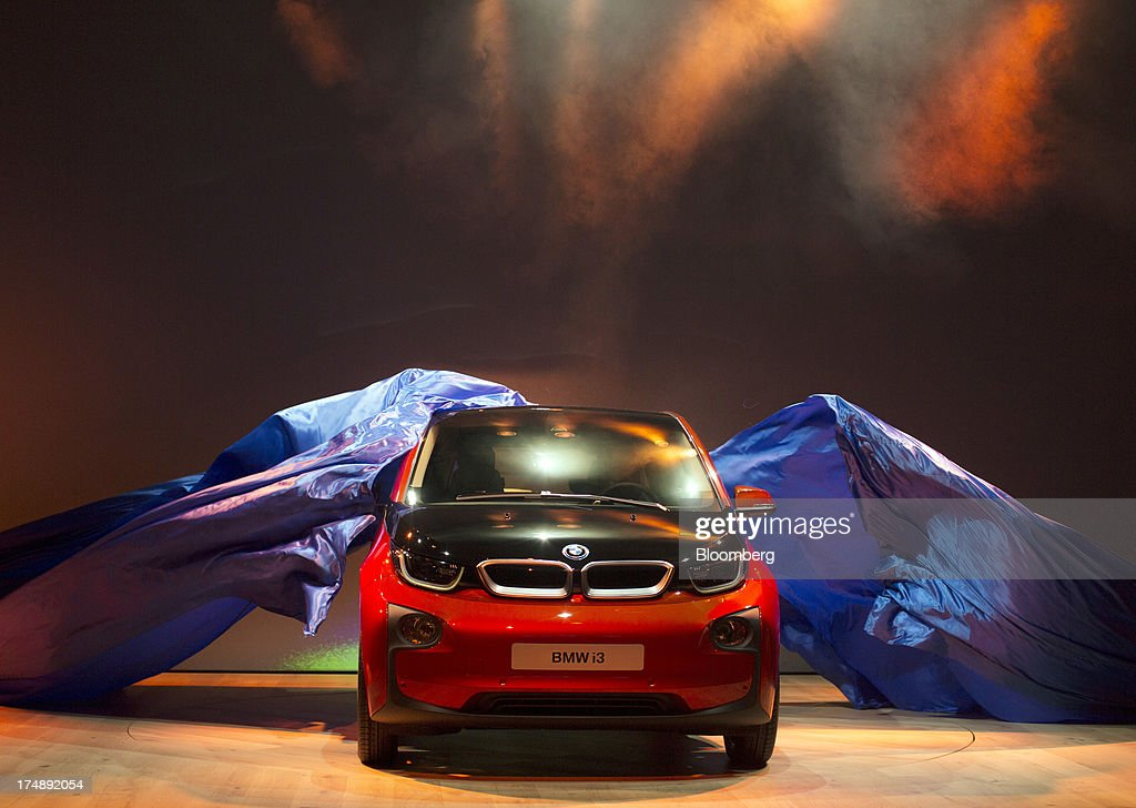 The BMW i3, the electric automobile produced by Bayerische Motoren Werke AG (BMW), is unveiled at the world premiere launch in London, U.K., on Monday, July 29, 2013. To avoid the fate of other slow-selling electric vehicles, Bayerische Motoren Werke AG will offer the new i3 -- a battery-powered compact car -- with a unique option: the use of a sport-utility vehicle. Photographer: Simon Dawson/Bloomberg via Getty Images