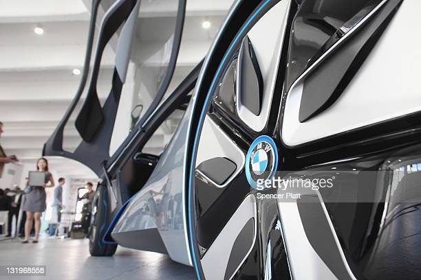 The BMW i8 concept vehicle is displayed at a sneak preview of the car along with the BMW i3 on November 9 2011 in New York City The fully electric...