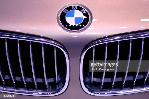 The BMW logo is seen during the 83rd Geneva Motor Show on March 6 2013 in Geneva Switzerland Held annually with more than 130 product premiers from...