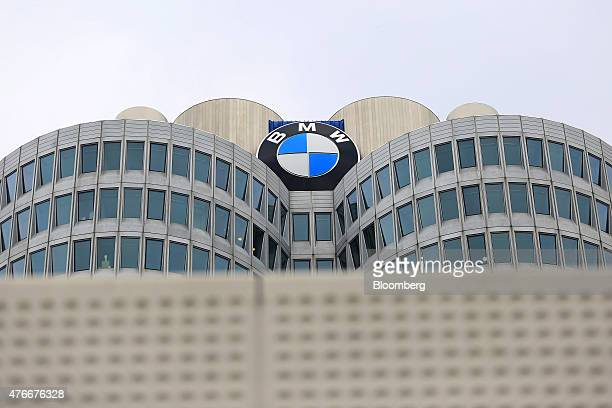 The BMW logo sits atop the towers of the Bayerische Motoren Werke AG's headquarters in Munich Germany on Thursday June 11 2015 BMW's topoftheline...
