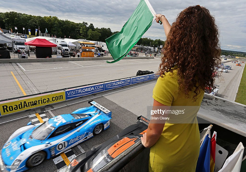 The #01 BMW Riley of <a gi-track='captionPersonalityLinkClicked' href=/galleries/search?phrase=Scott+Pruett&family=editorial&specificpeople=541449 ng-click='$event.stopPropagation()'>Scott Pruett</a> and <a gi-track='captionPersonalityLinkClicked' href=/galleries/search?phrase=Memo+Rojas&family=editorial&specificpeople=3547976 ng-click='$event.stopPropagation()'>Memo Rojas</a> of Mexico takes the green flag at the start of the VisitFlorida.com Sports Car 250 at Road America on August 10, 2013 in Elkhart Lake, Wisconsin.