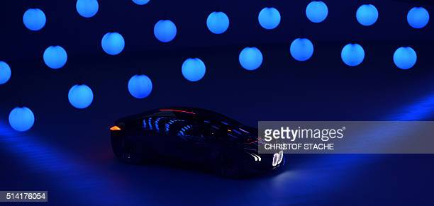 The BMW vision car 'The next 100 years' arrives at a stage during a celebration show marking of the 100th anniversary of BMW on March 7 2016 in the...