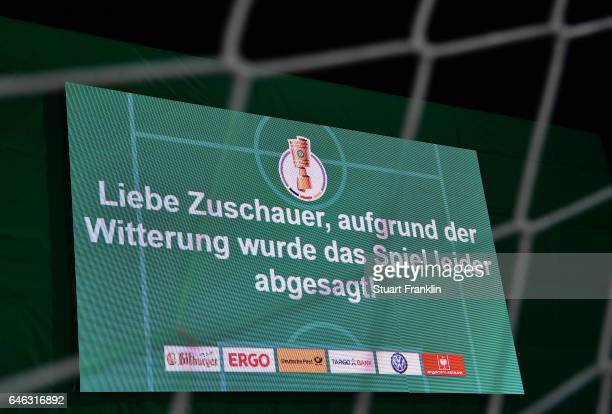 The board announces that the match is postponed due to a waterlogged pitch before the DFB Cup quarter final between Sportfreunde Lotte and Borussia...