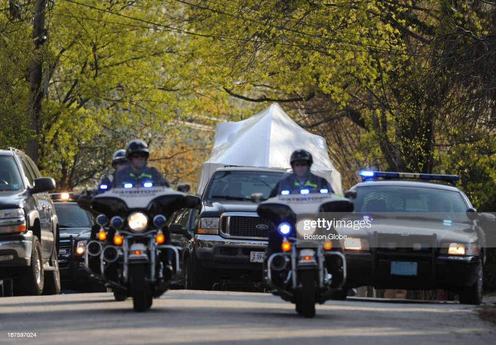 The boat where the second Boston Marathon bombing suspect was found hiding in last week, was moved away from the Franklin Street address in Watertown, Mass. on April 26, 2013.
