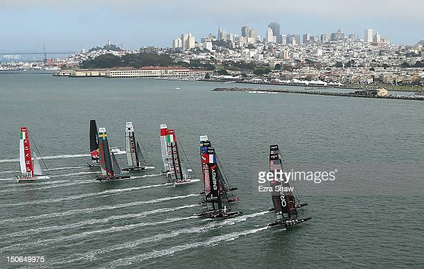 The boats cross the starting line during a fleet race in the America's Cup World Series on August 23 2012 in San Francisco California
