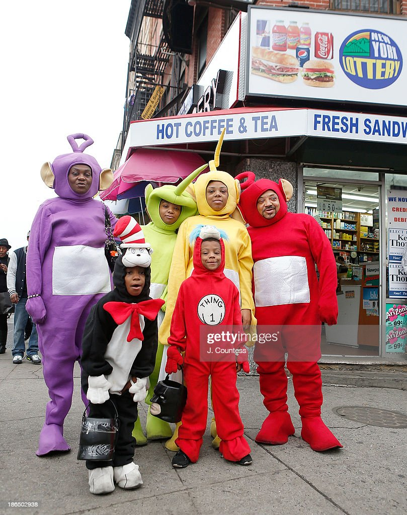 The Bobbit family of BedfordÐStuyvesant, Brooklyn pose for a photo in the heart of 'Bedstuy' as they 'Trick or Treat' at local businesses on Fulton Ave. on October 31, 2013 in New York City.