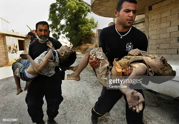 QANA LEBANON – The bodes of two young boys who were found buried in the rubble are rushed to the ambulance More than 50 people are believed to have...