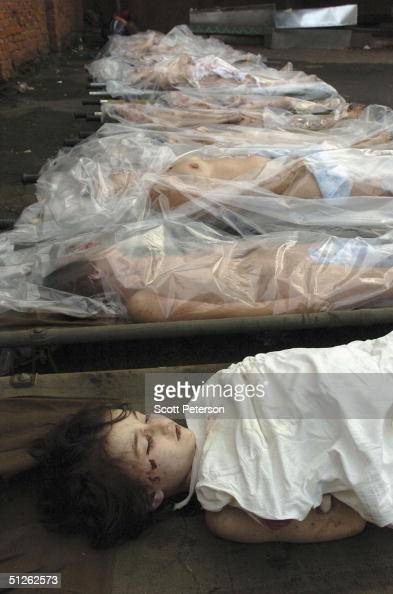 The bodies of 330 known dead lie in the city mortuary the day after the threeday Russian school siege in Beslan in which Chechen separatists held...